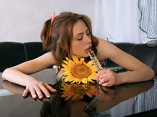Sweetie plays with sunflower and dildo